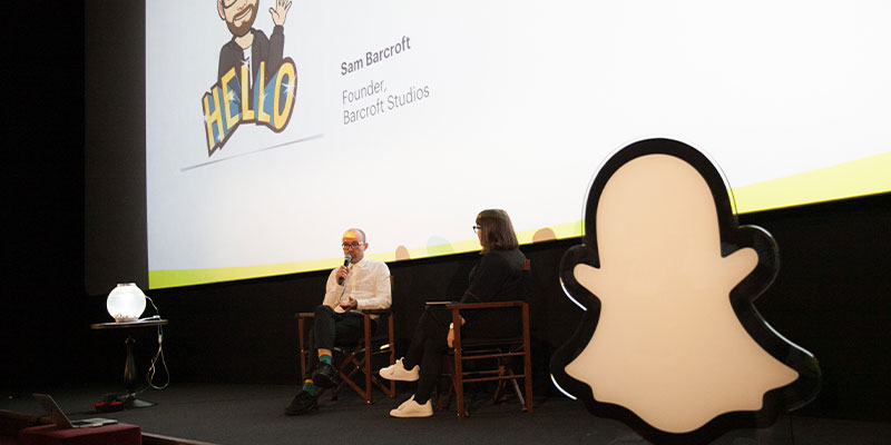 Conversation on stage with two people front of Snap logo
